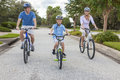 Young Family Parents And Boy Son Cycling Royalty Free Stock Image - 26240176