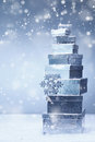 Stacked Christmas Gifts In Winter Snowfall Royalty Free Stock Images - 26258169