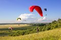 Multiple Paragliders Soar In The Air Royalty Free Stock Photo - 26273215