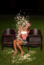 Beautiful Girl Down His Popcorn Order To Expose You Scared Royalty Free Stock Image - 26283236