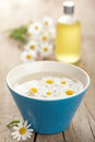 Camomile Flowers And Essential Oil Stock Photo - 26324440