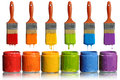 Paintbrushes Dripping Into Paint Containers Royalty Free Stock Photo - 26335485