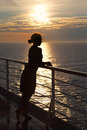 Silhouette Of Woman Standing On Deck Stock Image - 26337581