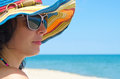 Woman Wearing Sunglasses And Hat Stock Photos - 26351733