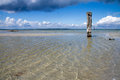 Old Wooden Post In Sea Royalty Free Stock Photography - 26355277
