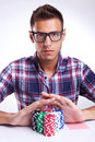Young Poker Player With Eyeglasses Going All In Royalty Free Stock Image - 26398716