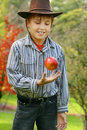 Young Boy In Country With Red Apple Royalty Free Stock Photo - 2649255