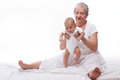 Grandmother Playing With A Baby Stock Photos - 26427653