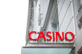 Red Signboard Of Casino On Old White Building. Royalty Free Stock Photography - 26442627