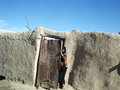 Girl Hiding Behind A Door In Afghanistan Stock Image - 26457261