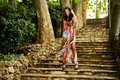 Young Woman, Model Of Fashion, In A Garden Stairs Royalty Free Stock Photo - 26462515