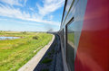 Train Goes By Rail In Summer Day Stock Photography - 26465082