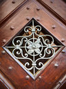 Metal Ornamental Pattern In Wooden Frame Stock Photos - 26473643