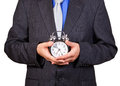 Businessman Holding A Clock Stock Image - 26483041