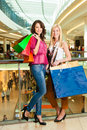 Two Women Shopping With Bags In Mall Royalty Free Stock Photo - 26486985