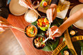 Young People Eating In Thai Restaurant Stock Photo - 26487010