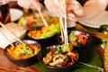 Young People Eating In Thai Restaurant Stock Images - 26487014
