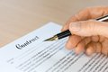 Hand With Fountain Pen Signing A Contract Royalty Free Stock Photography - 26487737