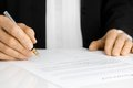 Hand Signing Contract With Fountain Pen Royalty Free Stock Photo - 26487965