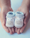 Dad Holds Shoes For Newly Born Baby Boy Stock Image - 26502771
