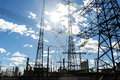 High Voltage Electrical  Towers Against Sky Stock Photography - 26512842