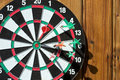 Dartboard On Wood Wall Stock Images - 26534784