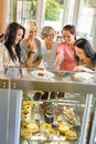 Group Of Friends Looking At Cakes Cafe Stock Photography - 26539082