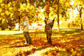 Children Playing With Autumn Fallen Leaves In Park Royalty Free Stock Images - 26570009