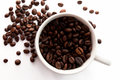 Coffee Beans And Coffe Cup Royalty Free Stock Photo - 26578955