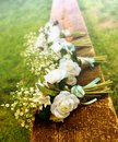 White Roses On A Bench Before A Country Wedding Royalty Free Stock Photos - 26579768