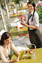 Waitress Waiting For Woman To Order Menu Stock Photography - 26592462