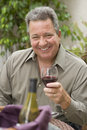Happy Man Holding Glass Of Wine Stock Photo - 26639720