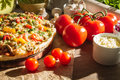 Pizza Made with Fresh Tomatoes Stock Image - 26717911
