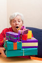 Senior Sitting On The Couch With Gifts Stock Image - 26718871