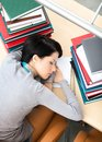 Female Student Sleeping At The Desk Royalty Free Stock Images - 26756689