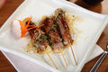 Chicken Skewers On White Plate Stock Photography - 26792252