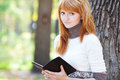 Beautiful Young Redhead Teenager Woman Reading Stock Images - 26807344