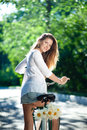 Woman And Bicycle Royalty Free Stock Photos - 26812528