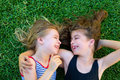 Sisters Kid Girls Smiling Lying On Garden Grass Stock Photography - 26815272