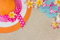 Hat And Flip Flops On Sand Stock Photos - 26820033