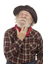 Old Cowboy Thinks And Scratches Whiskers Royalty Free Stock Photography - 26844967