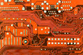Close Up Of Red Computer Circuit Board Royalty Free Stock Photo - 26875265