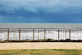 Waves Seen Through Stainless Steel Fence Royalty Free Stock Photo - 26881085