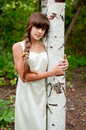 Russian Girl In White Dress In A Birch Forest Stock Image - 26890171