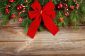 Red Ribbon Bow On Wooden Board Stock Images - 26892284