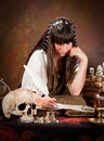 Witch Writing In The Book Of Shadows Stock Image - 26927641