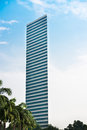 Skyscraper With Blue Sky And And Palms Royalty Free Stock Images - 26930909
