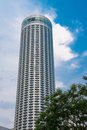 Skyscraper With Blue Sky And And Tree Stock Image - 26930921
