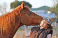 Horse & Pretty Young Lady Sharing Kisses & Laughs Royalty Free Stock Photos - 26948958