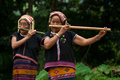 Khmu Hilltribe Playing Flute With Nose. Stock Photo - 26987330